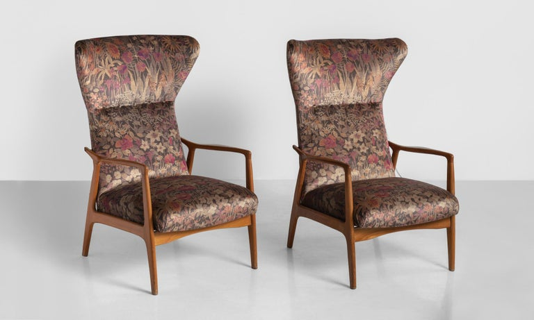 Modern wingback armchairs, France, circa 1950.