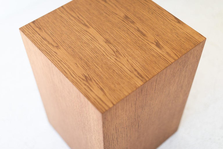 This modern wood side table in oak is made in the heart of Ohio with locally sourced wood. Each table is a hand-made mitered box from white oak veneer and finished with a beautiful matte commercial-grade finish. These are made to order so you can