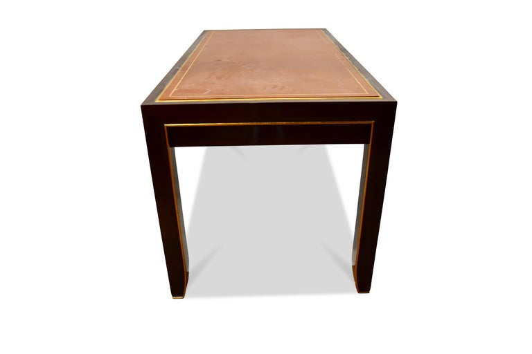 The stamped leather inset top with giltwood trim over a similarly trimmed mahogany desk with 2 drawers. Needs. Restoration Signed inside drawer.