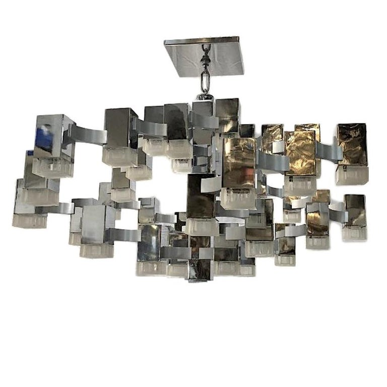 A circa 1960s Italian nickel-plated light fixture with lights covered by original molded Lucite insets.