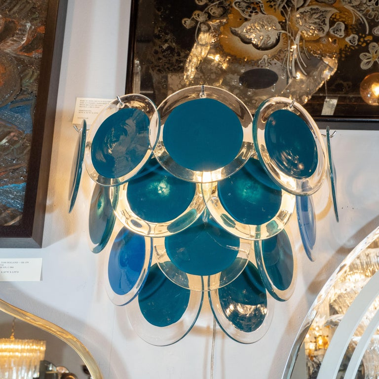 This beautiful pair of modernist 14-disc Vistosi sconces were made exclusively for High Style Deco by our atelier in Murano, Italy- the island off the coast of Venice, renowned for centuries for its superlative glass production. Realized in the