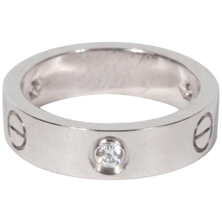 "Modernist 18 Karat White Gold & Three Diamond ""Love"" Ring/Wedding Band, Cartier For Sale"