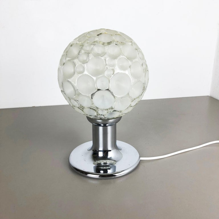 Article:  Sputnik table light   Producer:  Honsel Lights, Germany attrib.   Origin:  Germany    Age:  1970s    This 1970s table light was made by Honsel Lights attrib. in Germany. The light is made of solid metal in chrome