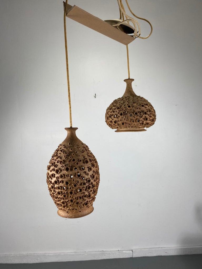 Modernist 1970s Studio Pottery handing pendant lamps by John Masson... Hand thrown fired stoneware.