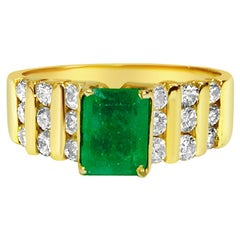 Modernist 2.70 Carat Emerald and Diamond Ring in 14 Karat Yellow Gold