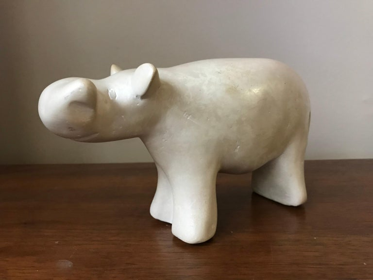 1950s-1960s modernist hippo sculpted from alabaster. Came from an artist's estate - everything was 1950s-1960s and most items were listed artists, besides her own work. This piece is unsigned. When set down, it slightly wobbles before coming to
