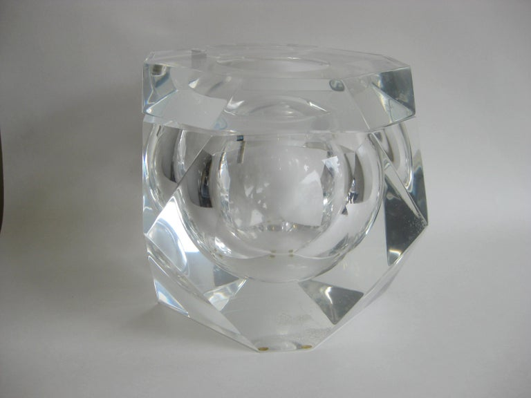Fantastic Lucite faceted edge ice bucket designed by Alessandro Albrizzi, circa 1970. Top swivels as it should. Outstanding form and design. In very nice original condition. No chips or cracks. Light surface wear on the bottom as expected from age.