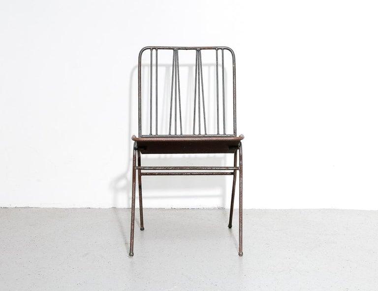 Vintage modernist steel side chair. Unpainted steel rod frame with steel sheet seat. Nice tilted-back seating position.  Measures: 17.75