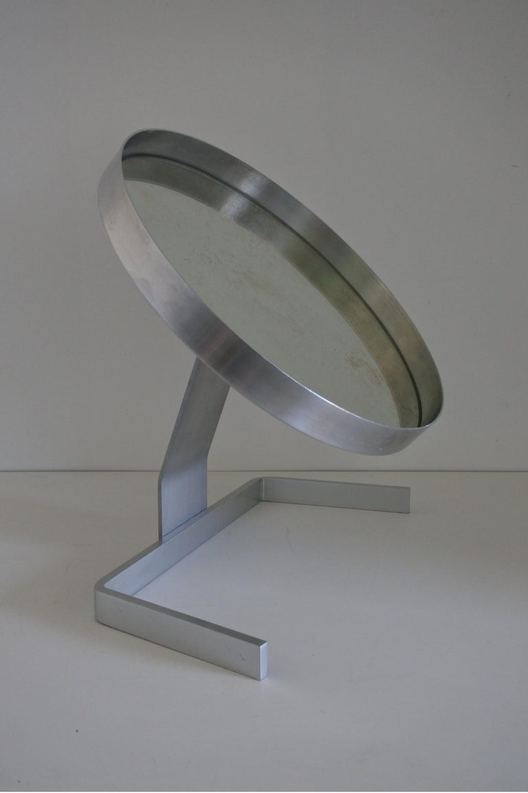 Modernist vanity or table mirror by French designer Pierre Vandel. Brushed and polished aluminum. Made in France in the late 1960s, early 1970s. Can be orientated up and down. Diameter of the mirror 40 cm.