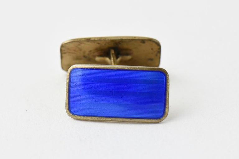 Mid 20th century blue enamel and gilded sterling silver cuff links. Marked: Norne (Aksel Holmsen) Norway 925.