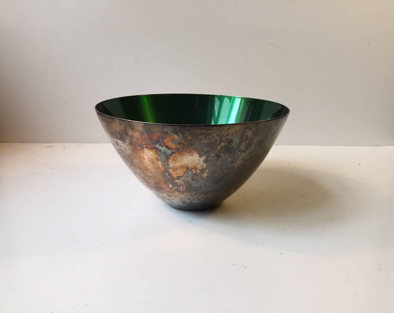 Patinated conical silver plate bowl decorated to the interior with a deep green enamel. Manufactured and designed in Denmark during the late 1950s by DGS (Danish silver- and goldsmith association). Stamped to the base. The silver plated exterior is