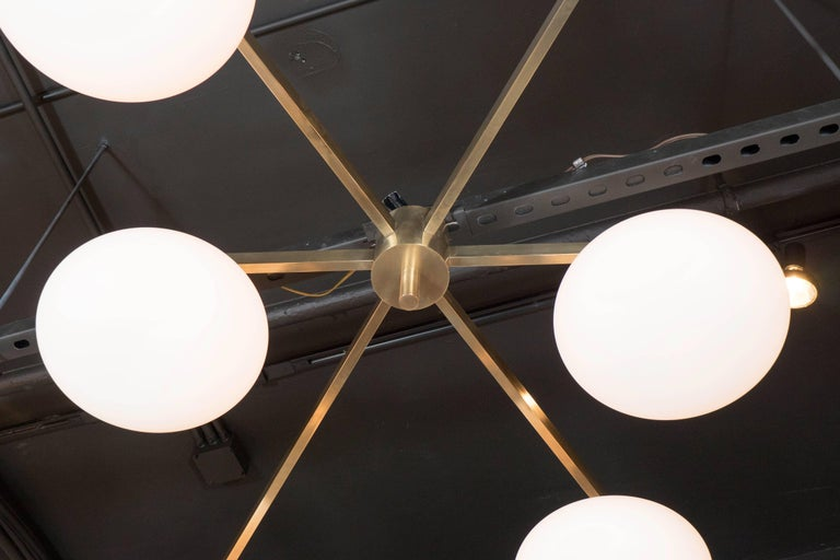 Modernist Brass and Frosted Glass Six-Arm Globe Chandelier, Manner of Arredoluce In Excellent Condition For Sale In New York, NY