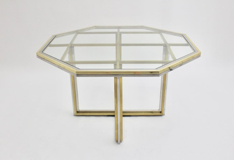 A Romeo Rega Style modernist brass and chromed vintage dining table or center table, 1970s, Italy. The octagonal Mid-Century Modern vintage dining or center table in the style of Romeo Rega was made of brass and chromed metal and appears as an