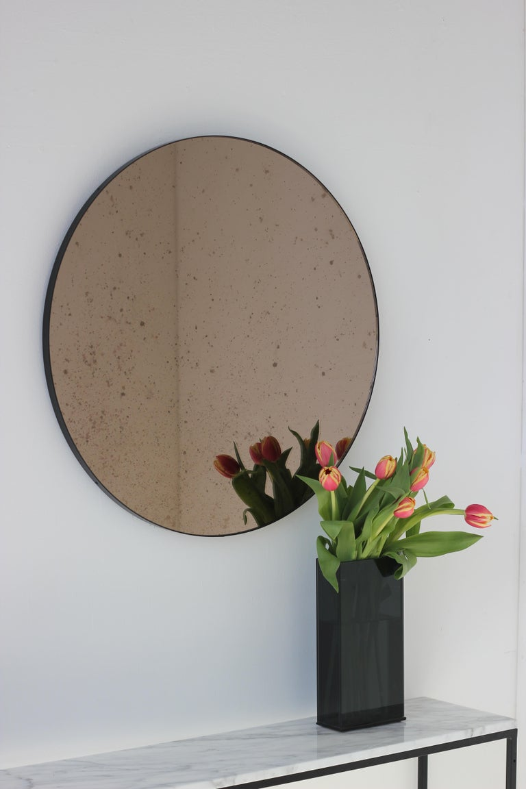 Modernist Bronze Tinted Antiqued Orbis Round Mirror Black Frame, Customizable In New Condition For Sale In London, GB