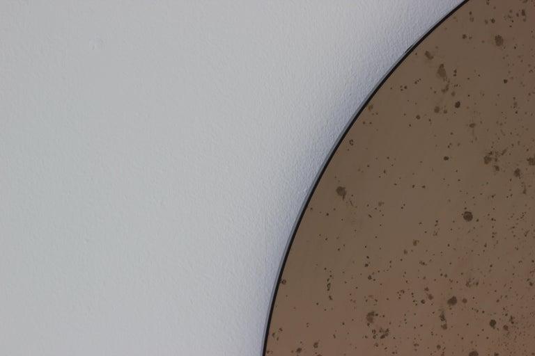 Modernist Bronze Tinted Antiqued Orbis Round Mirror Black Frame, Customizable For Sale 1