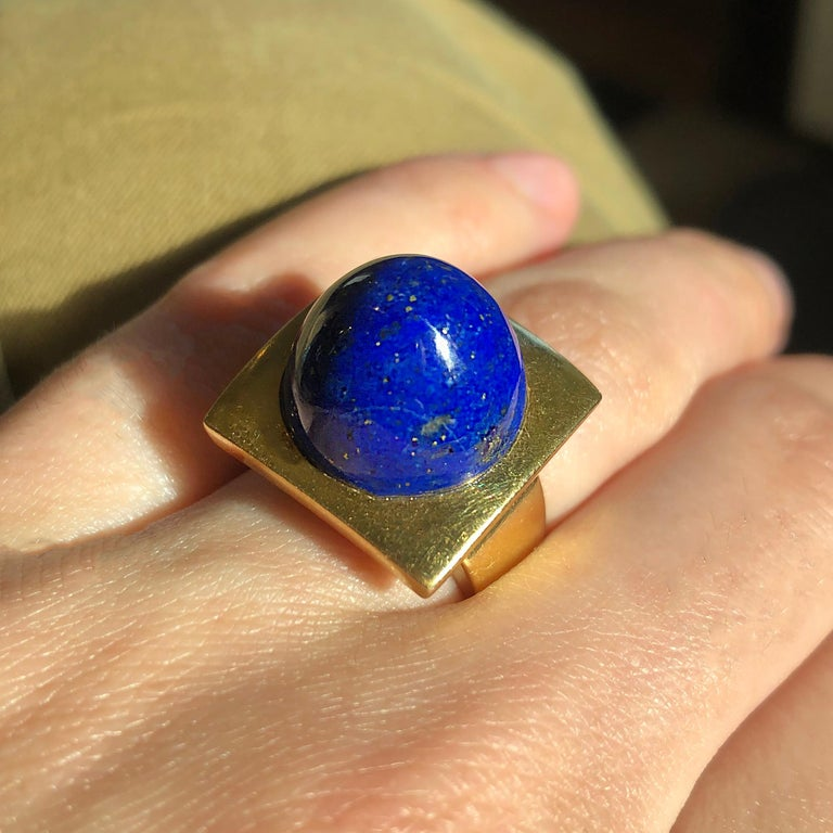 A perfectly proportioned lapis lazuli cabochon and 18 karat gold ring. The ring is a size 6.25 and it is stamped 18 kt, Germany.