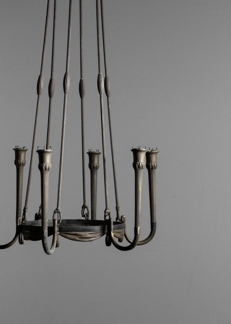 Rare chandelier in bronze from 1930s.
