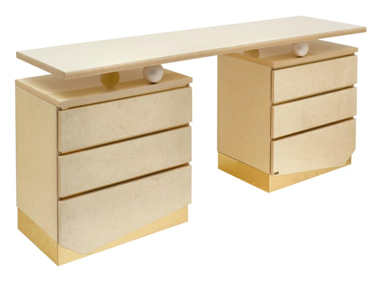 Modernist chest and mirror by Eric Maville for Jean-Claude Mahey. These beautiful pieces make a stunning vanity. They are made of unique lacquered wood and the chest features three drawers on each side with brass detailing. We love the impact of the