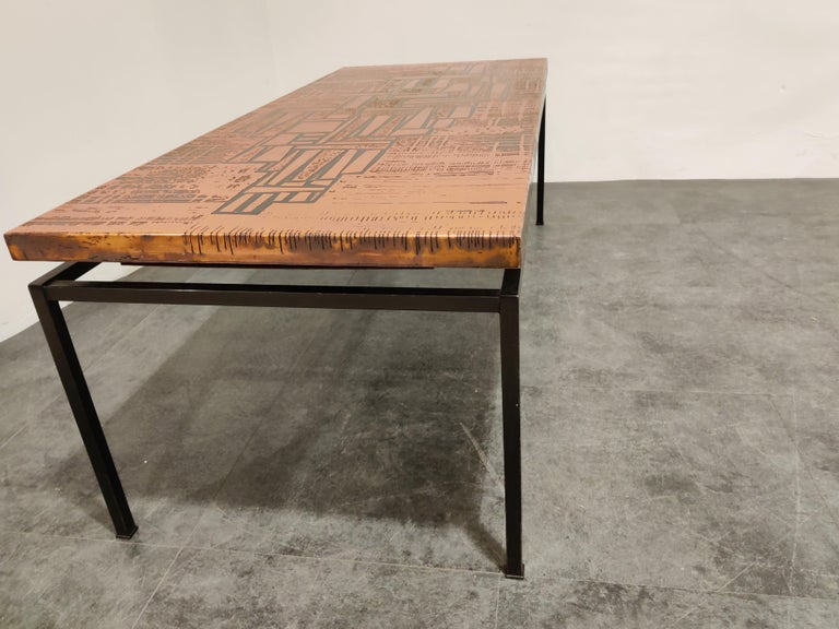 Midcentury copper-plated coffee table with a modernist design in the style of Bernhard Rohne.  Black lacquered steel base.  Very good condition.  Beautiful design,  1960s, Germany  Dimensions:  Height 49cm/19.29
