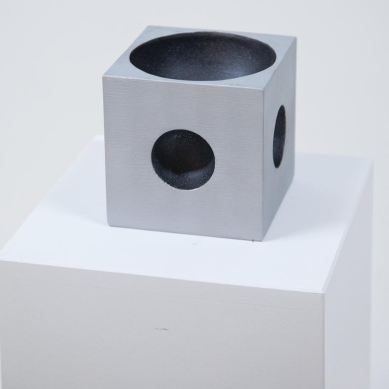 A Modernist cube sculpture. By artist Lorenzo Burchiellaro. Textured cast aluminum with concave top and side details. Signed underneath Burchiellaro.