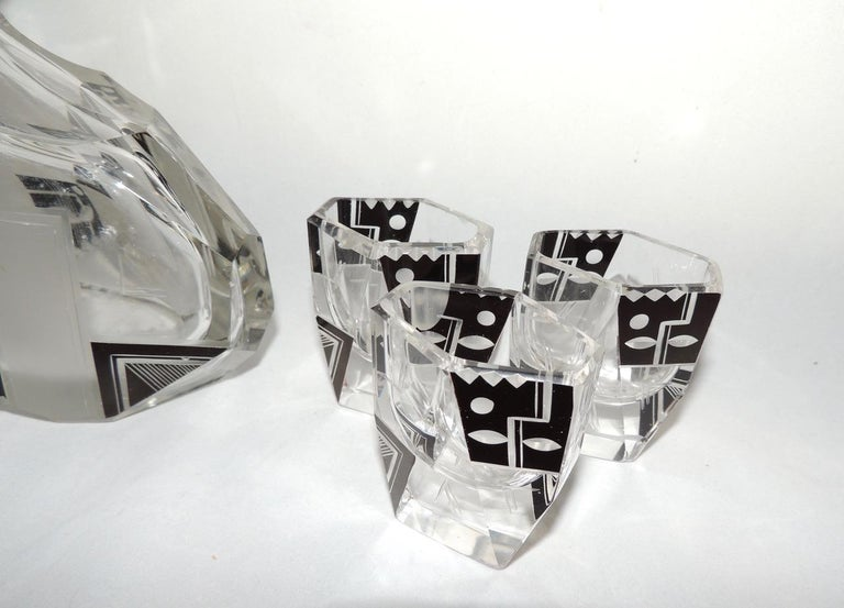 A modernist decanter and glasses with unusual shape and a design that is both geometric, streamlined yet whimsical. This is a great example of  the artistic approach to cut glass from Bohemia with hundreds of years of tradition in the fine
