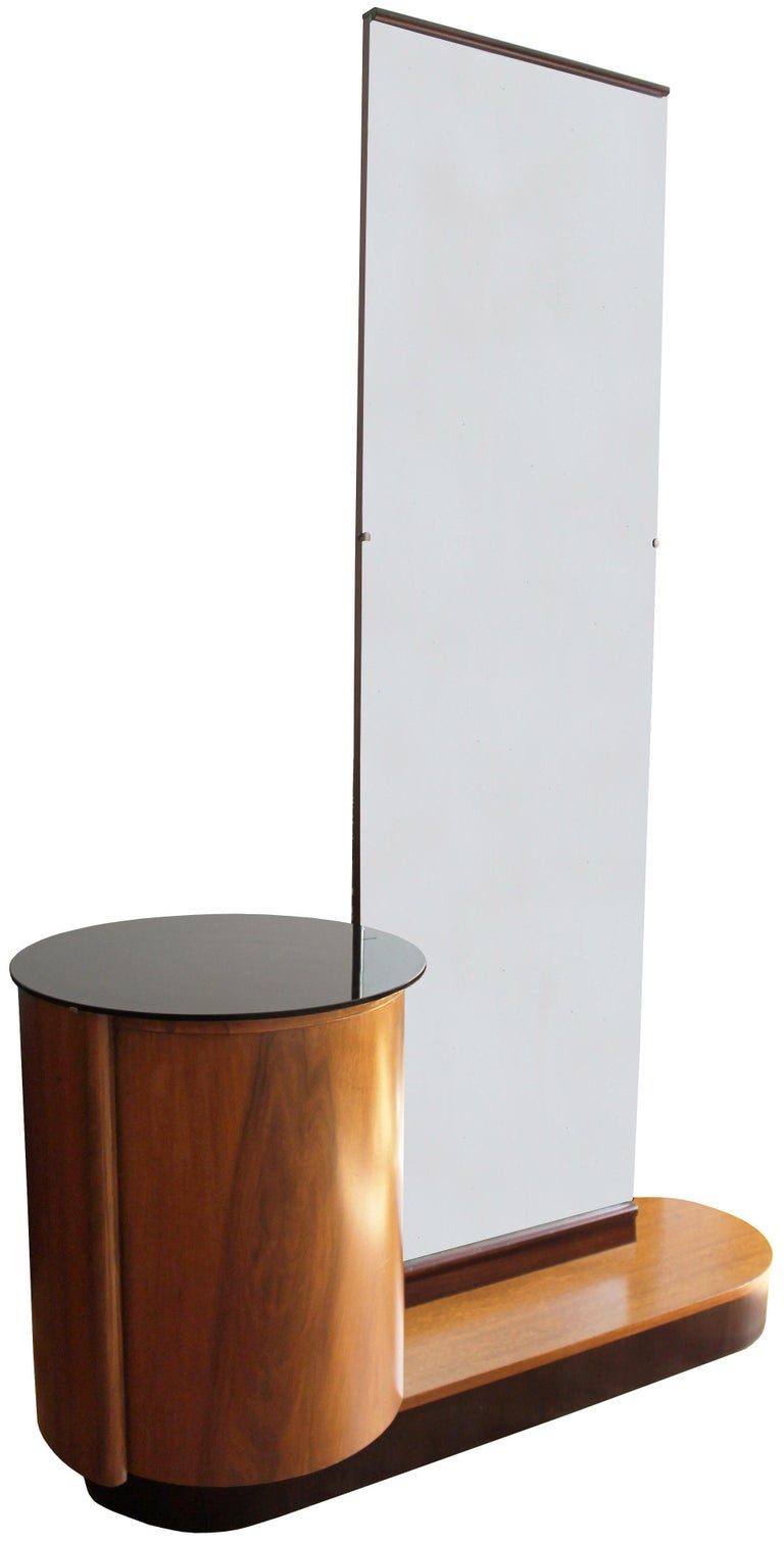 An early Modernist dressing table with a vertical mirror and drum shaped cabinet.  This piece was produced by UP Brno in 1930s under the direction of Jindrich Halabala. In true Bauhaus style, this piece is a perfectly balanced composition of