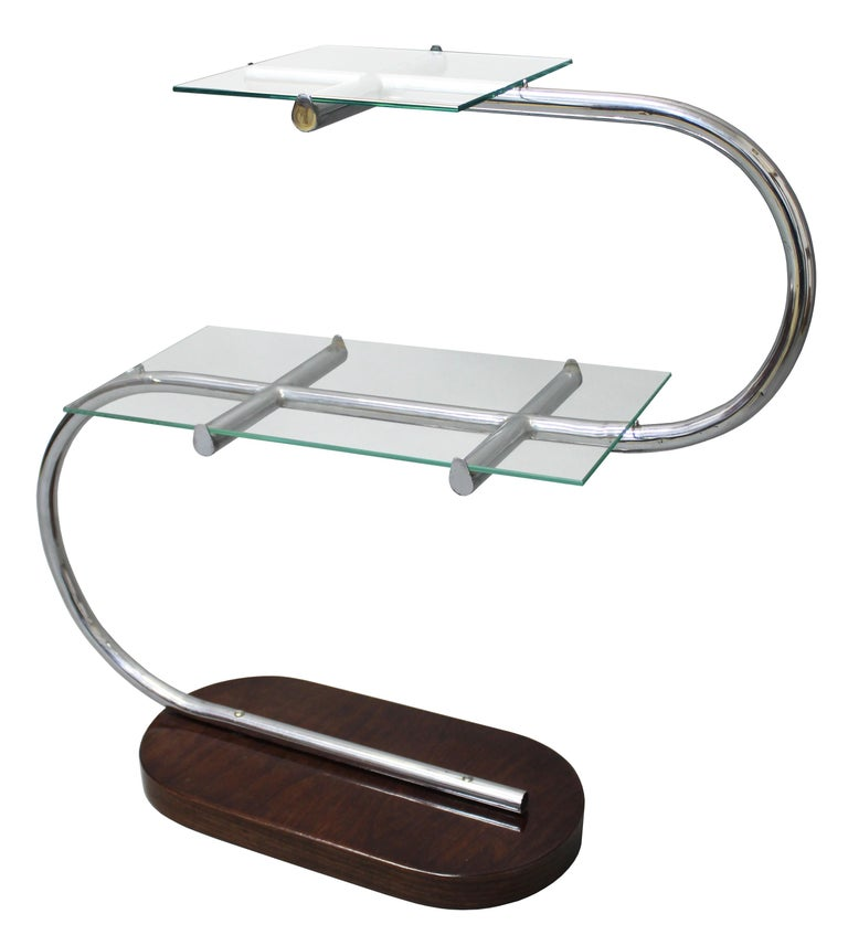 This 's' shaped flower stand represents perfectly the modernist approach to furniture design. Its Minimalist, functional and elegant.  In the 1920s and 1930s there were many variations of flower stands designed by different architects and produced