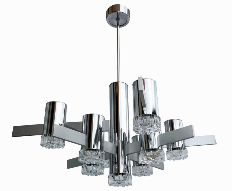Original sculptural vintage Gaetano Sciolari polished chrome and brushed aluminum chandelier. Nine-light textured glass diffusers on chrome frame. Made in Italy in the 1960s.