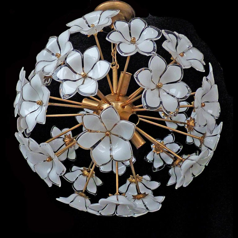 Vintage midcentury Italian Murano flower bouquet attributed to Venini. Art-glass with hand blown white and clear art glass flowers and gilt brass. Pair also available. Measures: Diameter 20 in/ 50 cm Height 27.5 in (chain=70 cm Weight 16 lb/7