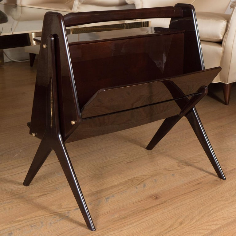 Modernist lacquered wood end table with brass details.