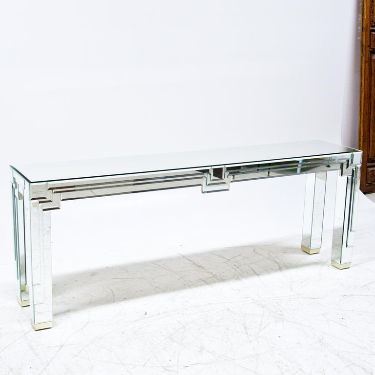 Long modernist mirrored console with layer mirrored details.
