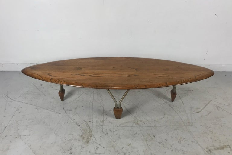Modernist oak and aluminum surfboard coffee/cocktail table, attributed John Keal. Truly a piece of art, sculpture. Solid. Beautifully grained oak beveled surfboard top, aluminum hair-pin legs with oak
