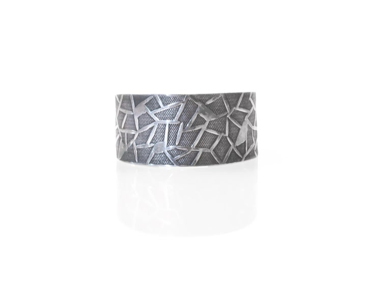 Wonderful and decorative silver bracelet in guilloche pattern. Designed and made by silversmith Øystein Balle 1960s first half in his workshop. The bracelet is in very good vintage condition.