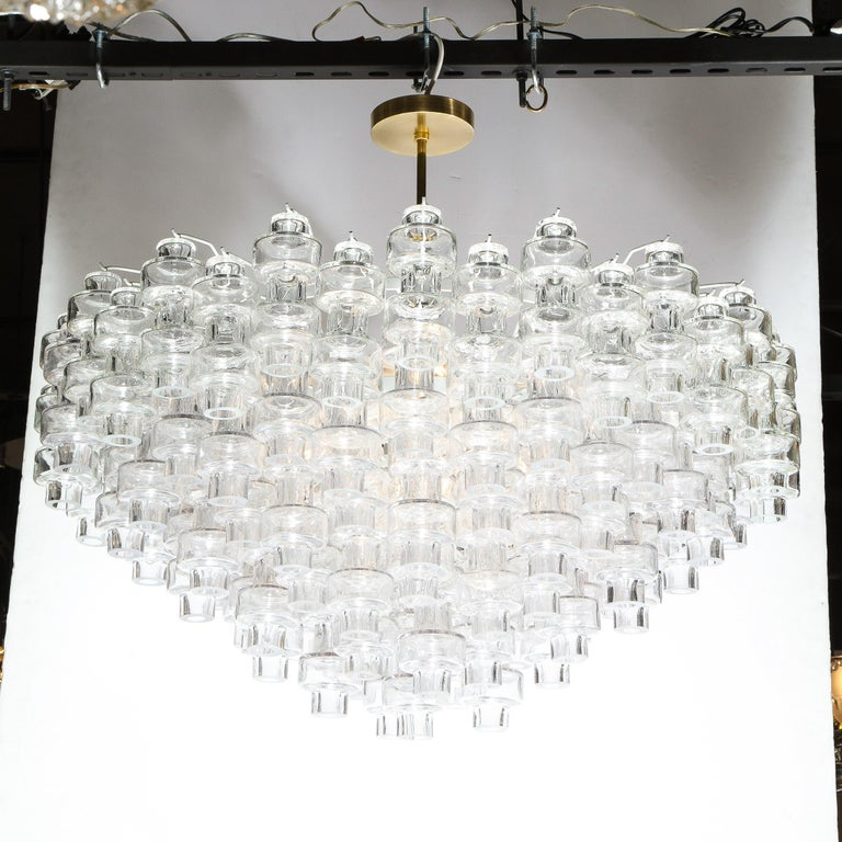 This outstanding Murano glass chandelier was realized in Murano, Italy- the island off the coast of Venice renowned for centuries for its superlative glass production. It features numerous translucent barbell shaped Murano glass shades hanging in a