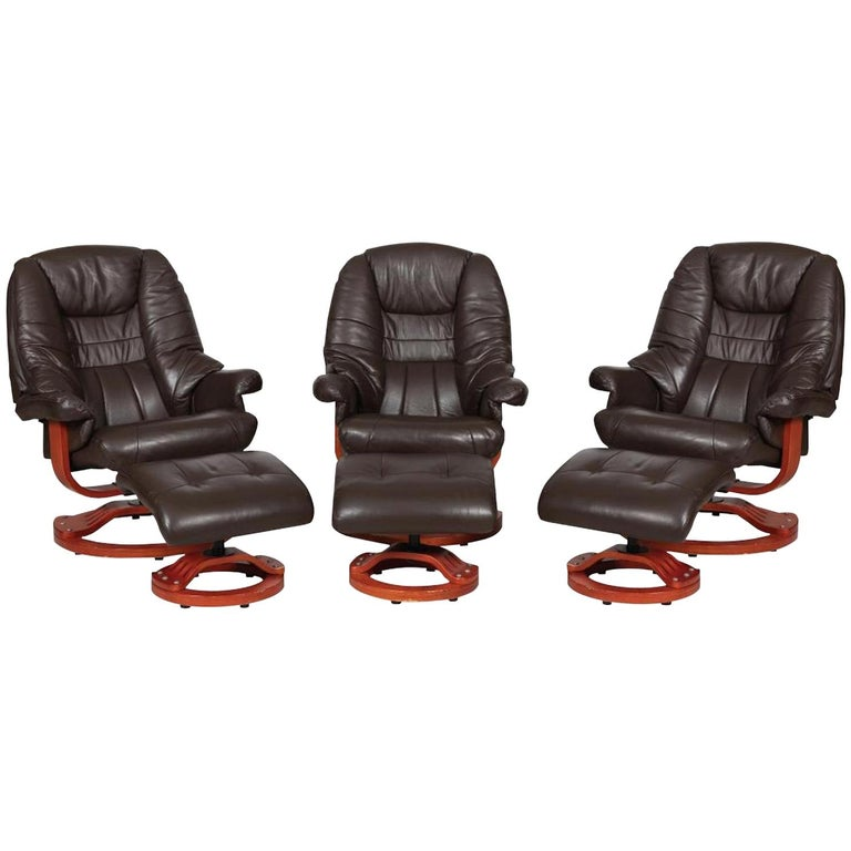 Modernist Scandinavian Leather Swivel Chairs with Ottomans For Sale