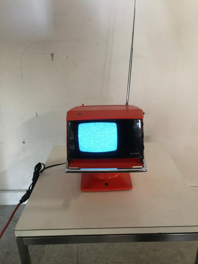 Modernist Space Age sharp television, model 3S-111 R..JAPAN, circa 1970. Amazing design, tested and in wonderful working condition  Note: The TV detaches from the base (which holds the transformer/power) and the chrome bar presses in to release to