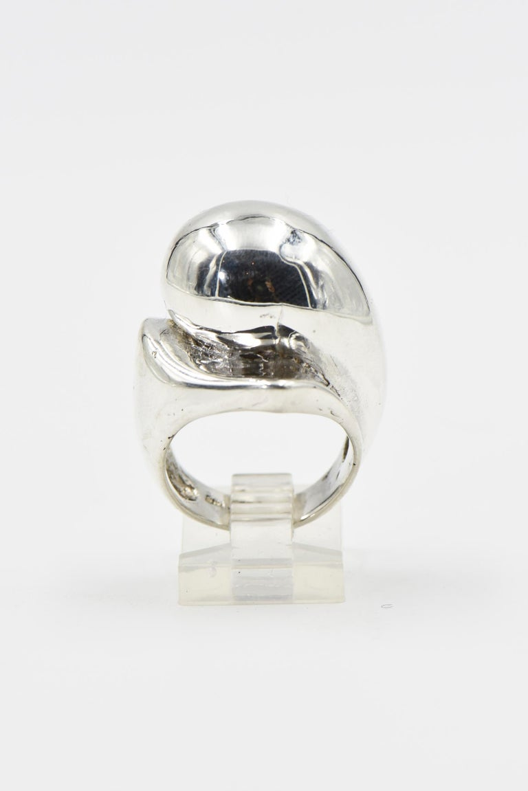 Modernist sterling silver ring. Size: 7 3/4. Marked inside. Age wear, scratches, tiny dings.