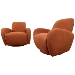 Modernist Swivel Club Chairs