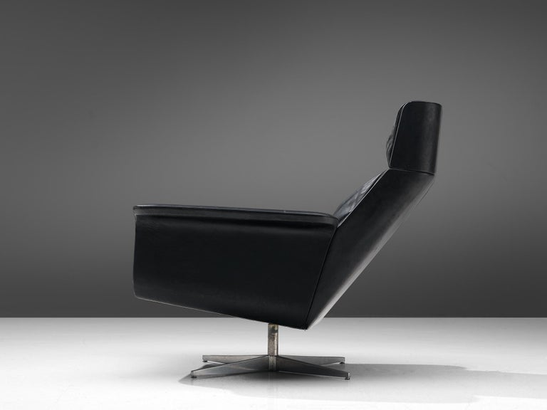 Mid-20th Century Modernist Swivel Lounge Chair with Ottoman in Black Leather For Sale