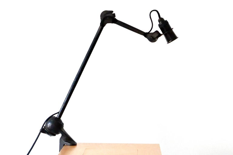 Articulated modernist task lamp or clamp table light. Extremely rare shorter execution of the model 201. Designed in 1920s by Bernard-Albin Gras. Manufactured in 1920s by Gras, France, 1920s.  Executed in black enameled steel and cast iron, the lamp