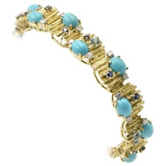Modernist Turquoise, Sapphire, Diamond and Topaz Gold Bracelet