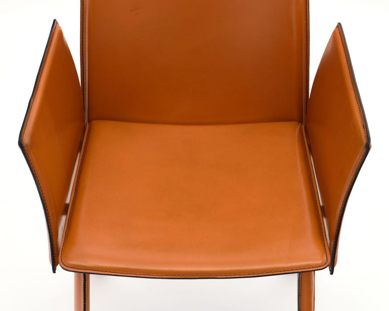 Modernist Vintage Orange Leather Armchairs In Good Condition For Sale In Austin, TX