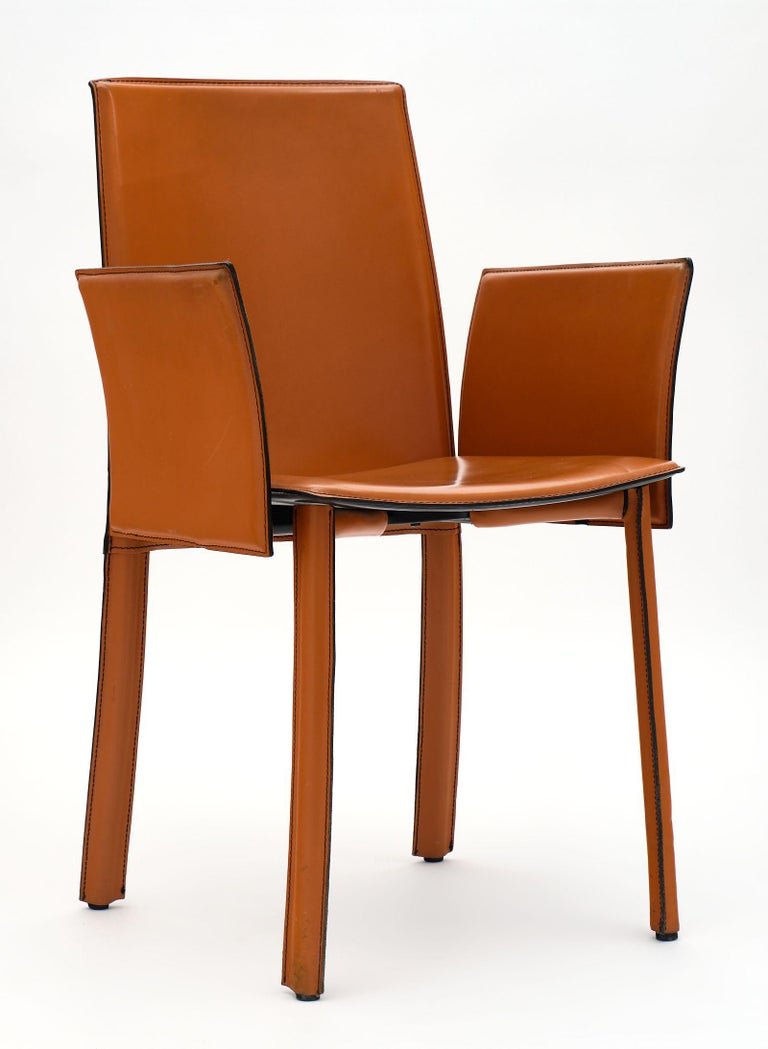 Late 20th Century Modernist Vintage Orange Leather Armchairs For Sale