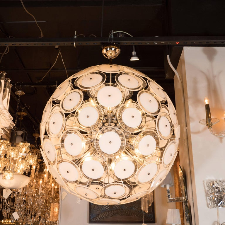 This stunning and dramatic chandelier was realized in Murano, Italy- the islands off the coast of Venice renowned for centuries for their superlative glass production. Created in the same manner since the 1960s, in the manner of Vistosi, features an