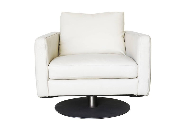 Modernist white swivel lounge chair with brush steel base and heavy vinyl covers by Permaguard.  Avalible: Two.
