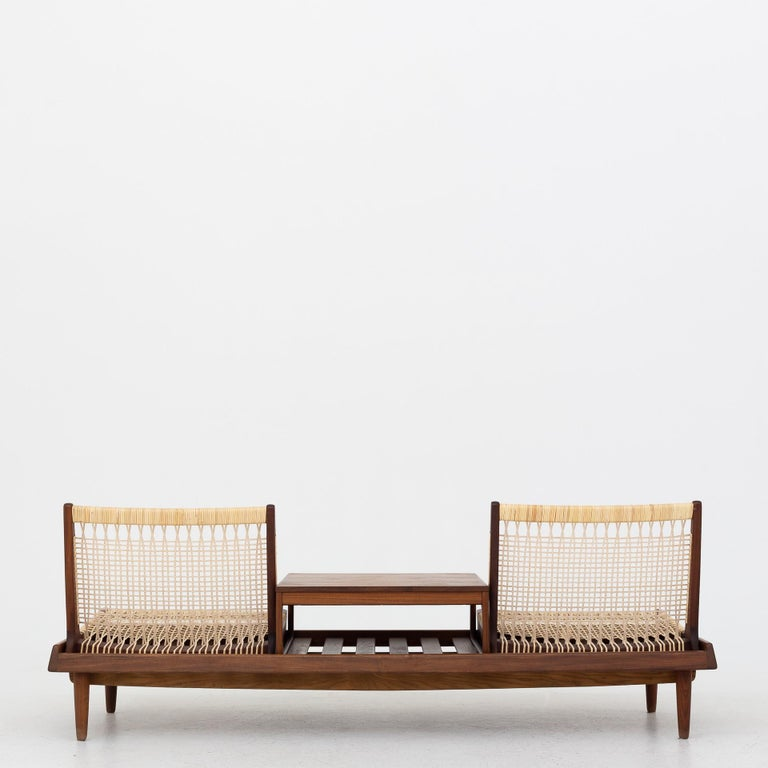 Modular set consisting of two chairs and a coffee table in teak and new cane. Model TV 161. Maker Frem Røjle Møbelfabrik.