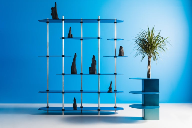 """Designed entirely around standard factory-made """"shaft collars"""" which clamp onto the posts to secure the shelves, the Hex Shelving system is easily assembled with nothing more than an allen key. A wide variety of shelf shapes and support sizes are"""