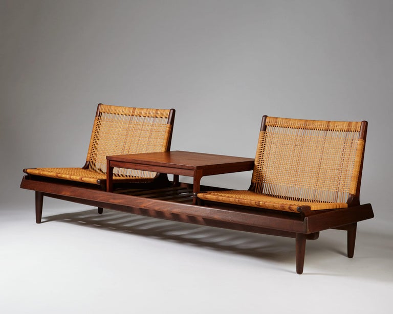 Teak and wicker. Model used in the Case Study House #20, known as the Bass House, completed in 1958.