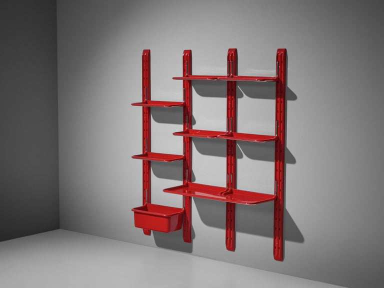 Alberto Rosselli for Saporiti, wall-unit 'Speedy', red plastic, chromed metal, Italy, 1970s  This funky wall-unit was designed by Alberto Rosselli, circa 1970. The red color of the plastic is eye-catching. In three columns shelves and a box can be