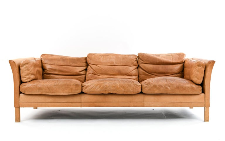 Lovely and comfortably worn thick leather sofa by Mogens Hansen.